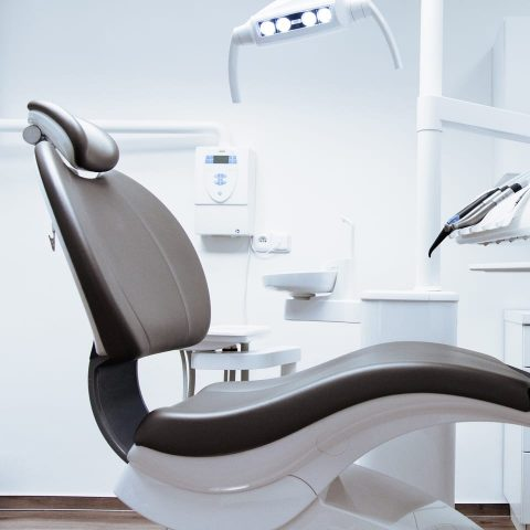 Curved seat in dentist surgery showing aluminium parts
